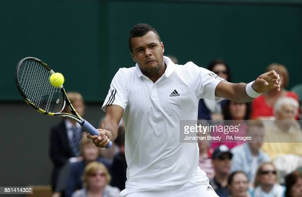 France's JoWilfried Tsonga in action against Latvia's Ernests Gulbis during day Three of the Wimbledon Championships at The All England Lawn Tennis...
