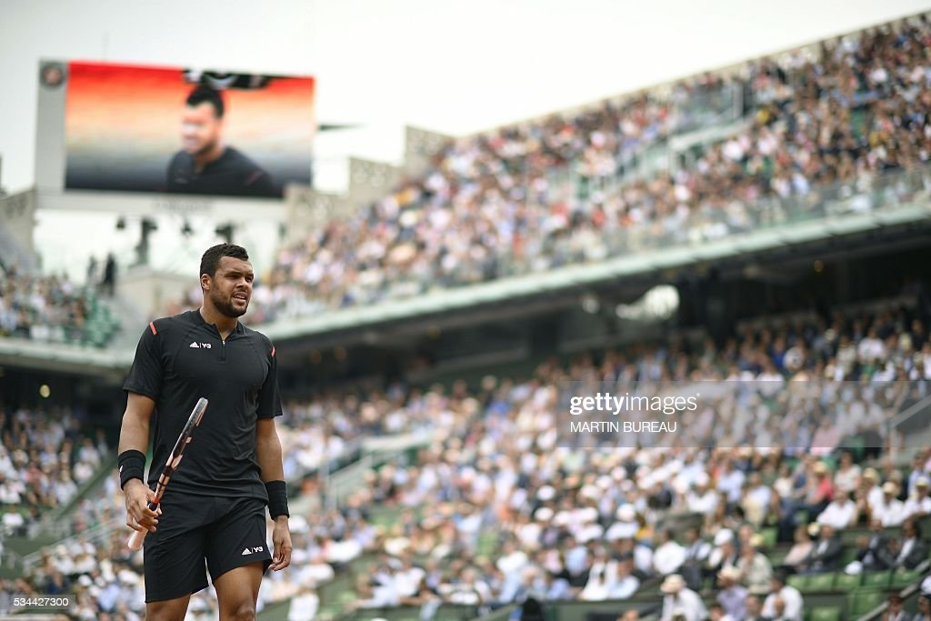 France's Jo-Wilfried Tsonga looks on during his men's second round match against Cyprus' Marcos Baghdatis at the Roland Garros 2016 French Tennis Open in Paris on May 26, 2016. / AFP / Martin BUREAU