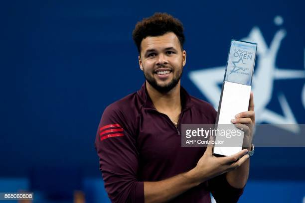 France's JoWilfried Tsonga poses after victory during his men's singles final tennis match against Argentina's Diego Schwartzman at the ATP Antwerp...