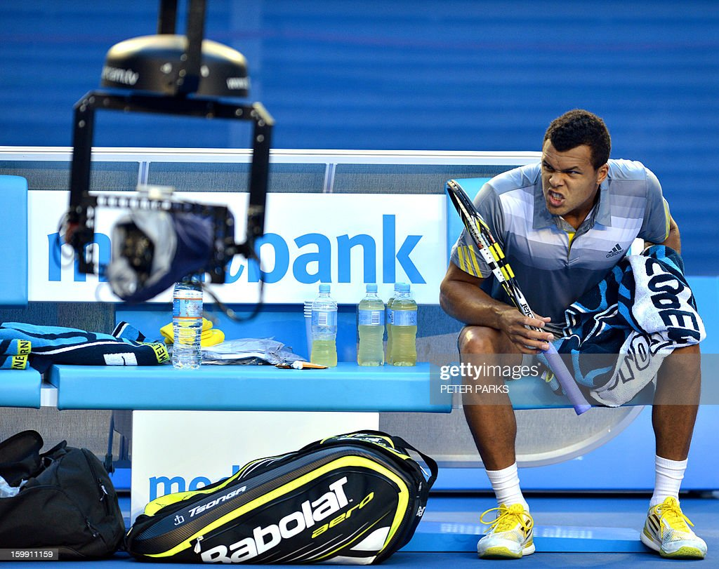 France's Jo-Wilfried Tsonga poses for a remote television camera ahead of his men's singles match against Switzerland's Roger Federer on the tenth day of the Australian Open tennis tournament in Melbourne on January 23, 2013.