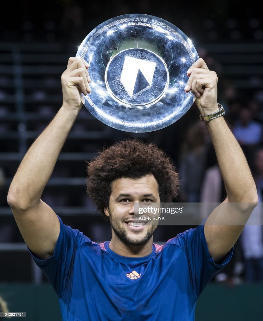 France's Jo-Wilfried Tsonga poses with his trophy after winning the final match of the Rotterdam World Tennis Tournament against David Goffin of Belgium in Rotterdam on February 19, 2017. / AFP / ANP / Koen SUYK / Netherlands OUT