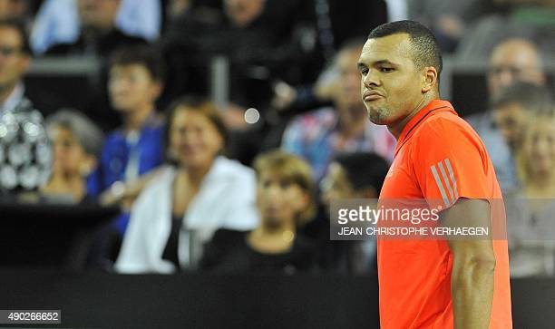 France's JoWilfried Tsonga reacts after losing a point during the ATP Moselle Open finals tennis match against France's Gilles Simon on September 27...
