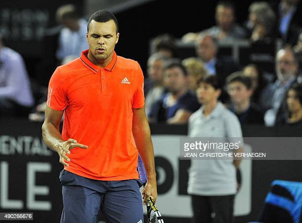 France's JoWilfried Tsonga reacts after winning a point during the ATP Moselle Open finals tennis match against France's Gilles Simon on September 27...