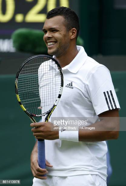 France's JoWilfried Tsonga reacts in his match against Latvia's Ernests Gulbis during day Three of the Wimbledon Championships at The All England...