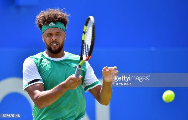 France's JoWilfried Tsonga returns against France's Adrian Mannarino in their men's singles 1st round match at the ATP Aegon Championships tennis...
