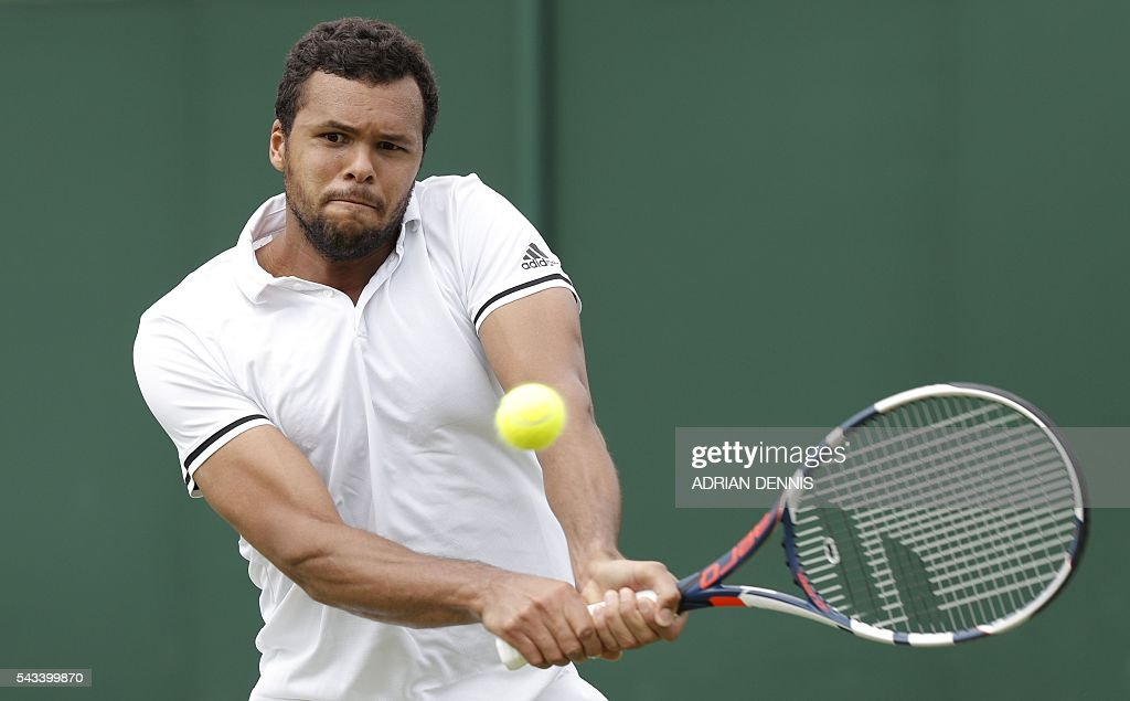 France's Jo-Wilfried Tsonga returns against Spain's Inigo Cervantes during their men's singles first round match on the second day of the 2016 Wimbledon Championships at The All England Lawn Tennis Club in Wimbledon, southwest London, on June 28, 2016. / AFP / ADRIAN