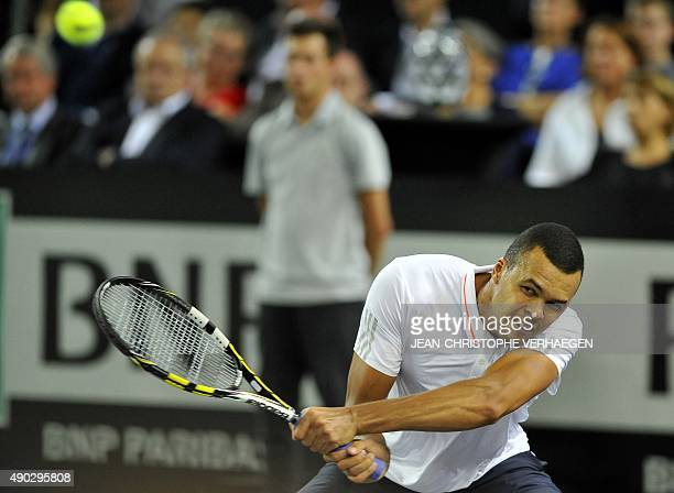France's JoWilfried Tsonga returns the ball during the ATP Moselle Open finals tennis match against France's Gilles Simon on September 27 2015 in...