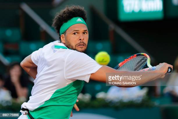 TOPSHOT France's JoWilfried Tsonga returns the ball to Argentina's Renzo Olivo during their tennis match at the Roland Garros 2017 French Open on May...