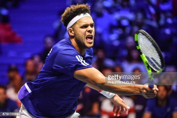 France's JoWilfried Tsonga returns the ball to Belgium's David Goffin during their singles rubber 4 of the Davis Cup World Group final tennis match...