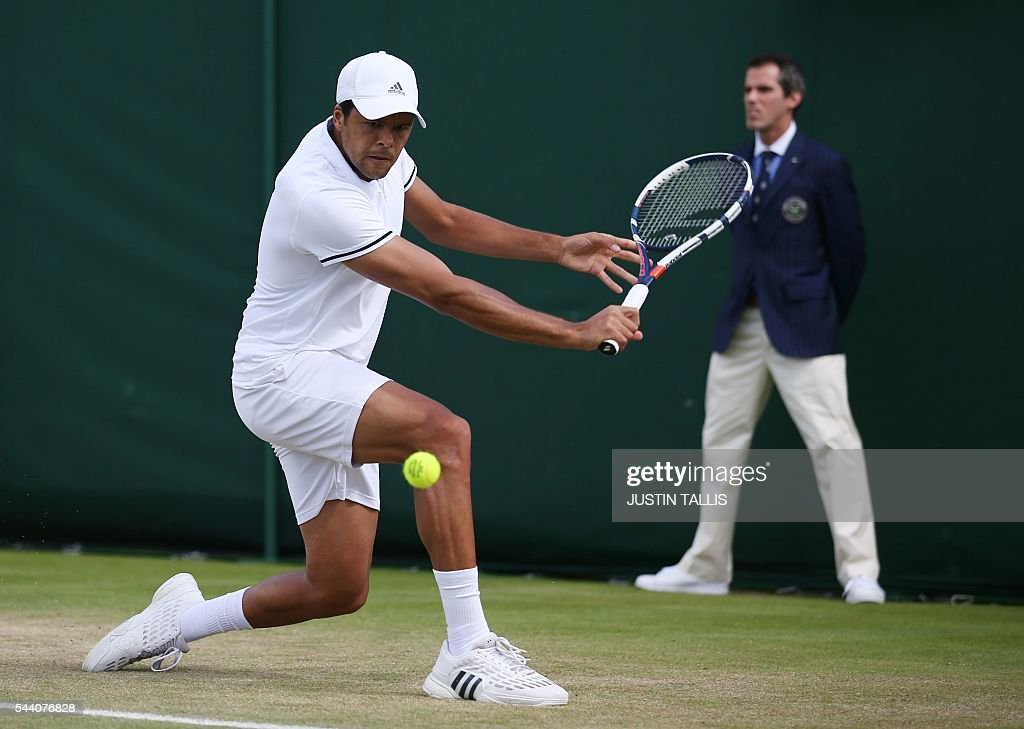 France's Jo-Wilfried Tsonga returns to Argentina's Juan Monaco during their men's singles second round match on the fifth day of the 2016 Wimbledon Championships at The All England Lawn Tennis Club in Wimbledon, southwest London, on July 1, 2016. / AFP / JUSTIN