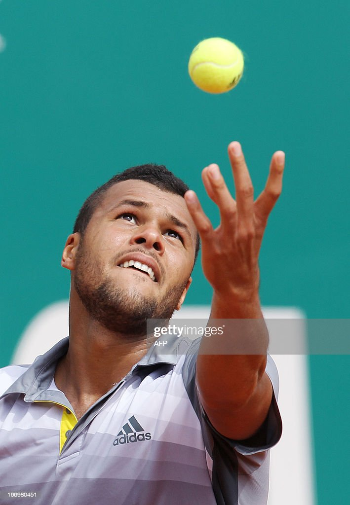 France's Jo-Wilfried Tsonga serves during his match against Switzerland's Stanislas Wawrinka at the Monte-Carlo ATP Masters Series Tennis Tournament on April 19, 2013 in Monaco.