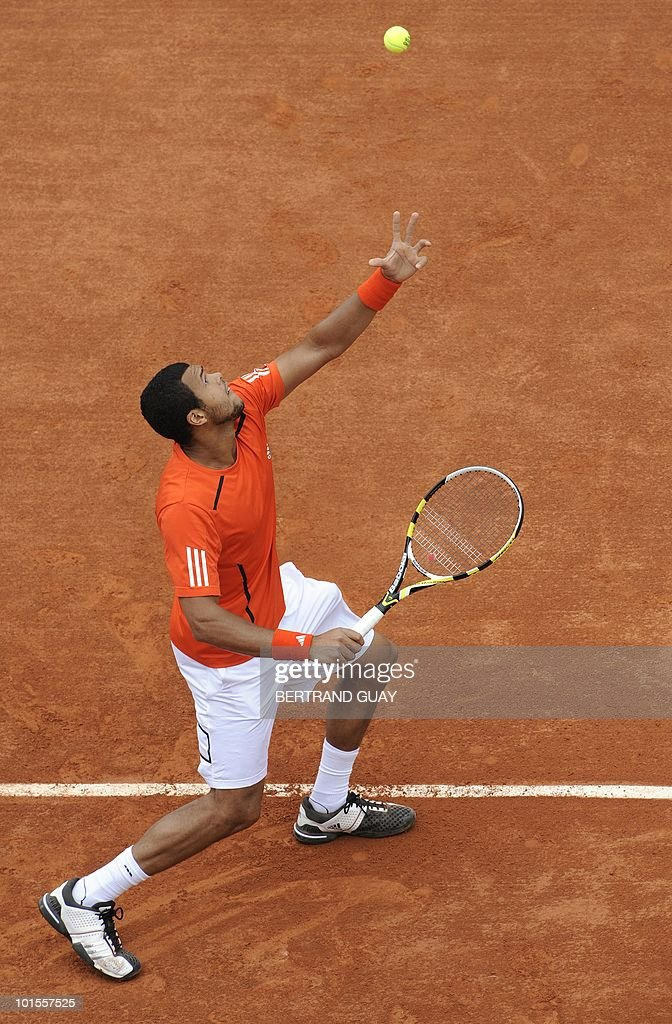 France's Jo-Wilfried Tsonga serves to France's Josselin Ouanna during their Men's second round match in the French Open tennis championship at the Roland Garros stadium, on May 26, 2010, in Paris.