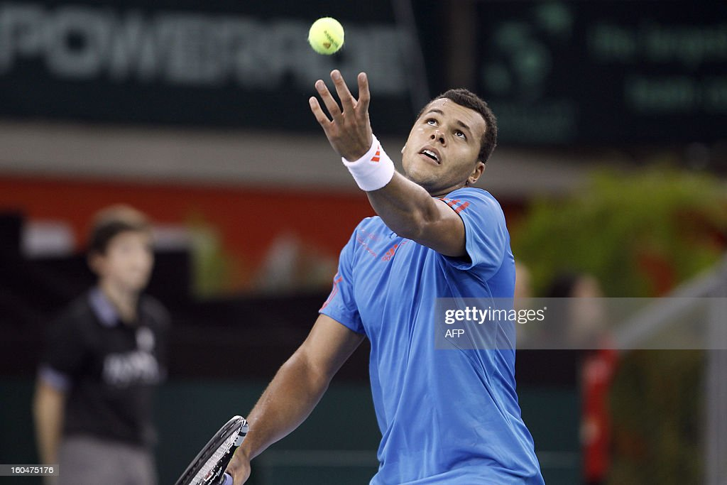 France's Jo-Wilfried Tsonga serves to opponent Israel's Amir Weintraub during the first singles match of the Davis Cup at the Kindarena stadium in Rouen on February 1, 2013. Tsonga won 6-3, 6-3, 4-6, 7-5. AFP PHOTO/CHARLY TRIBALLEAU.