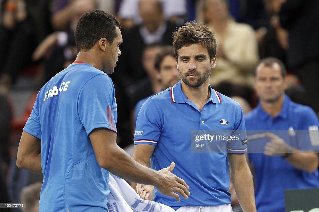 France's Jo-Wilfried Tsonga shakes hand with France's headcoach Arnaud Clement during the first singles match of the Davis Cup at the Kindarena stadium in Rouen on February 1, 2013. Tsonga won 6-3, 6-3, 4-6, 7-5.