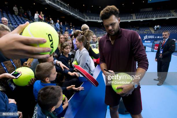 France's JoWilfried Tsonga signs autographs after the Antwerp tennis tournament final match between Tsonga and Schwartzman on October 33 2017 in...