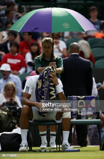 France's JoWilfried Tsonga sits dejected in his chair before retiring in his match against Latvia's Ernests Gulbis after retiring from the match...