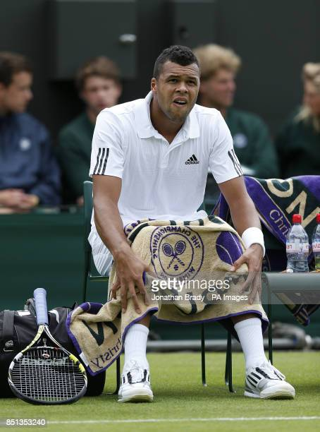 France's JoWilfried Tsonga sits on his chair in between games against Belgium's David Goffin during day one of the Wimbledon Championships at The All...