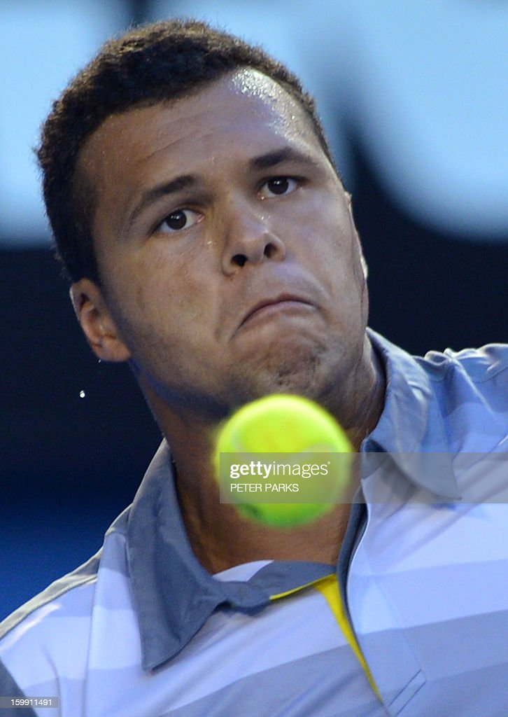 France's Jo-Wilfried Tsonga watches the ball as he plays a return during his men's singles match against Switzerland's Roger Federer on the tenth day of the Australian Open tennis tournament in Melbourne on January 23, 2013.