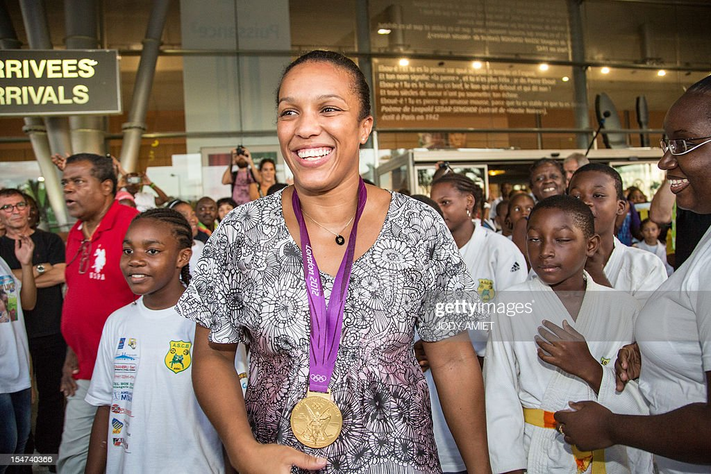 France's judo athlete and 2012 Olympic Games gold medalist Lucie Decosse is welcomed by supporters on October 24, 2012 in Cayenne, French overseas region of Guiana. The 30-year-old world champion beat German outsider Kerstin Thiele in the final of the women's -70kg judo contest match of the London 2012 Olympic Games on August 1, 2012.