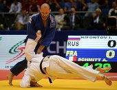 France's judoka Alain Schmitt competes with Russia's Ivan Nifontov during the under 81 kg category competition for bronze medal at the IJF World Judo...