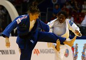 France's judoka AnneLaure Bellard competes with France's Clarisse Agbegnenou during the under 63 kg category semifinal at the IJF World Judo...