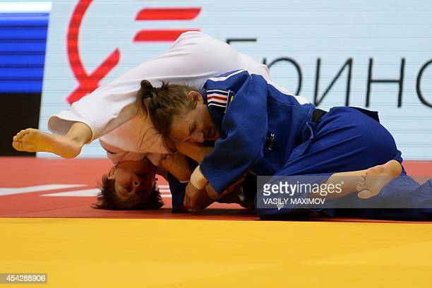 France's judoka AnneLaure Bellard competes with Slovenia's Tina Trstenjak during the under 63 kg category competition for bronze medal at the IJF...