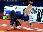 France's judoka Automne Pavia competes with Brazil's Rafaela Silva during the under 57 kg category competition for bronze medal at the IJF World Judo...
