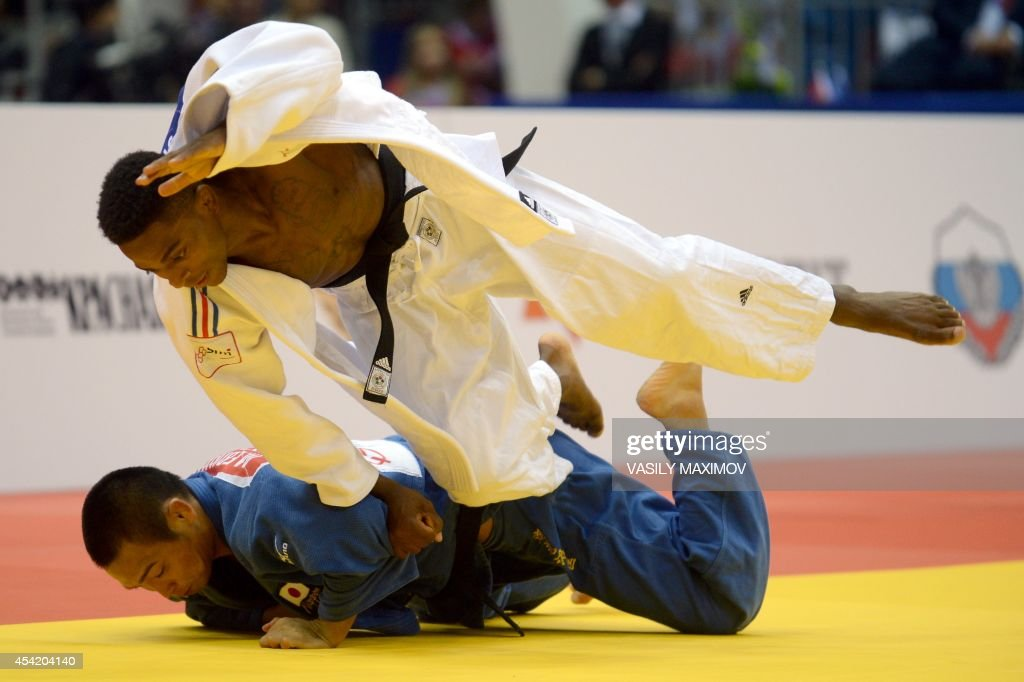 France's judoka Loic Korval (white) competes with Japan's Masashi Ebinuma during the under 66 kg category semi-final at the IJF World Judo Championship in Chelyabinsk on August 26, 2014.