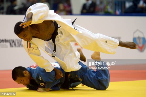 France's judoka Loic Korval competes with Japan's Masashi Ebinuma during the under 66 kg category semifinal at the IJF World Judo Championship in...