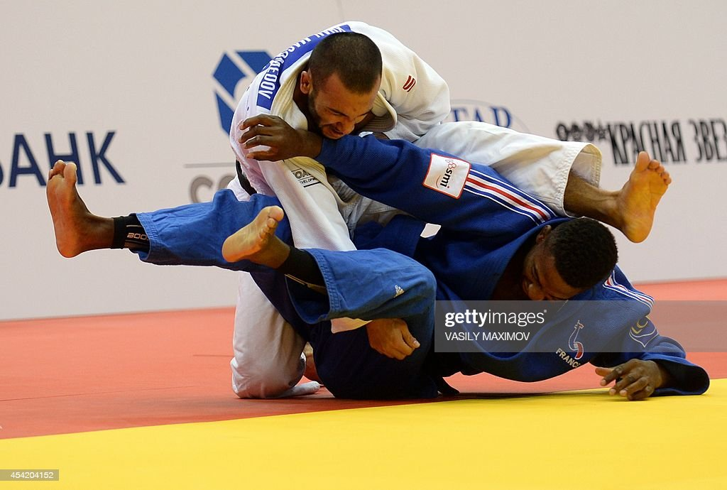 France's judoka Loic Korval (blue) competes with Russia's Kamal Khan-Magomedov during the under 66 kg category competition for bronze medal at the IJF World Judo Championship in Chelyabinsk on August 26, 2014.