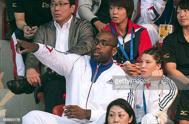 France's judoka Teddy Riner sits in the stands during the team competition at the Judo World Championships in Astana on August 30 2015 Riner won his...