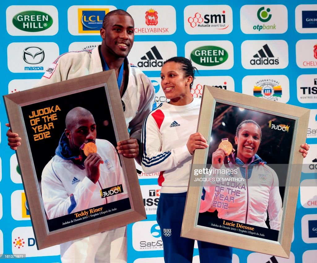 France's judokas Teddy Riner (L) and Lucie Decosse (R) pose with their '2012 year judokas' trophies during Paris Judo Grand Slam tournament, at the Palais Omnisports de Paris-Bercy (POPB) in Paris, on February 10, 2013. AFP PHOTO/JACQUES DEMARTHON