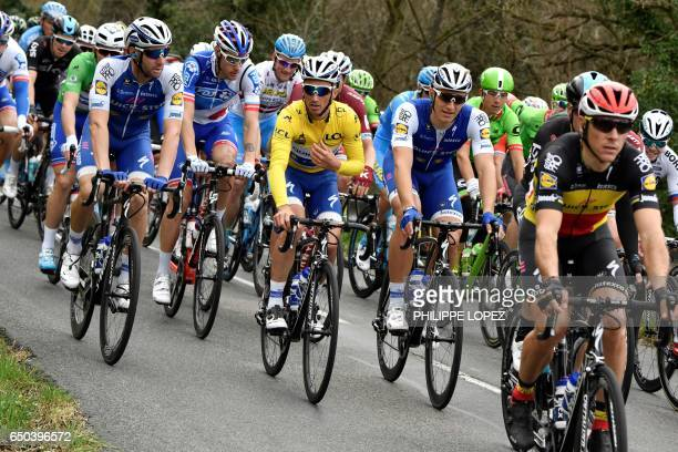 France's Julian Alaphilippe wearing the overall leader's yellow jersey rides in the pack with his tammates of the Belgium's Quick Step Floors cycling...
