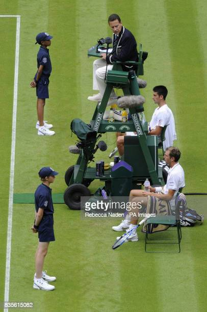 France's Julien Benneteau and Serbia's Novak Djokovic during the 2009 Wimbledon Championships at the All England Lawn Tennis and Croquet Club...