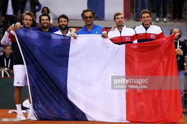 France's Julien Benneteau Jeremy Chardy Nicolas Mahut Lucas Pouille Jonathan Eysseric and France's captain Yannick Noah pose with a French flag after...