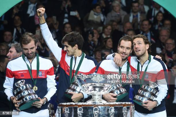 France's Julien Benneteau PierreHugues Herbert Richard Gasquet and Lucas Pouille celebrate with the trophy after winning the Davis Cup World Group...
