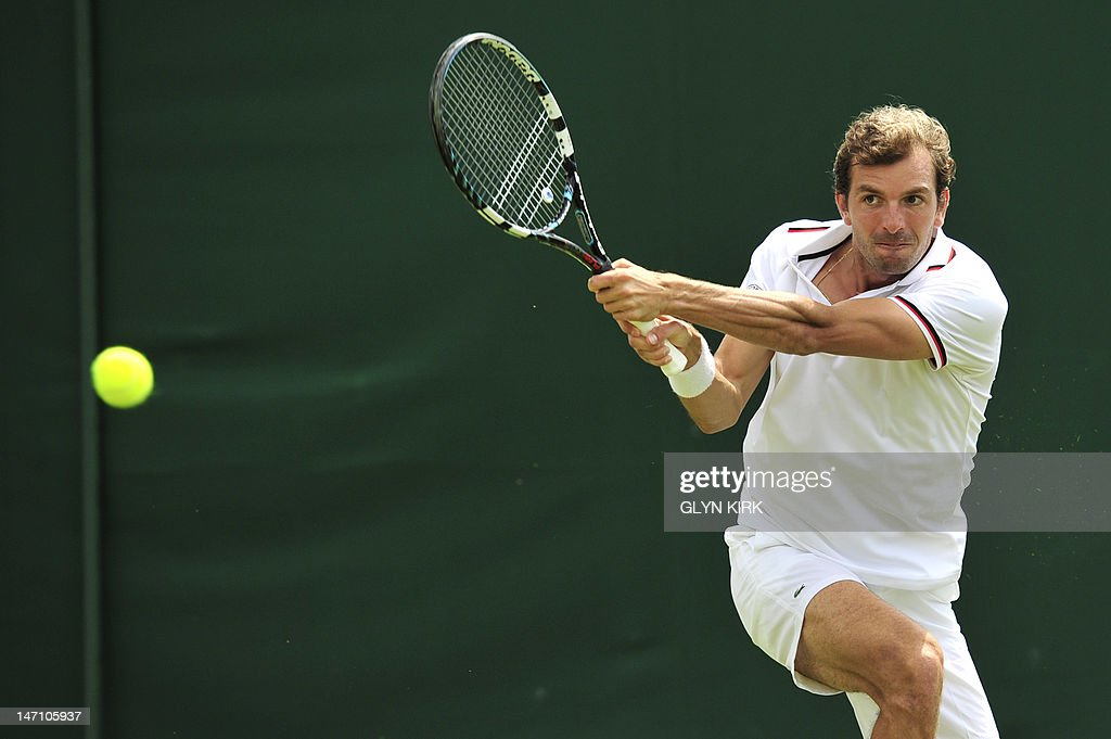 France's Julien Benneteau plays a shot during his first round men's singles match against Luxembourg's Gilles Muller on the first day of the 2012 Wimbledon Championships tennis tournament at the All England Tennis Club in Wimbledon, southwest London, on June 25, 2012.
