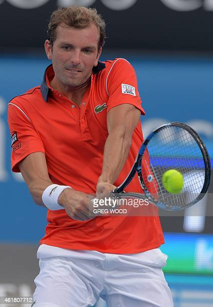 France's Julien Benneteau plays a shot during his men's singles match against Germany's Benjamin Becker on day two of the 2015 Australian Open tennis...