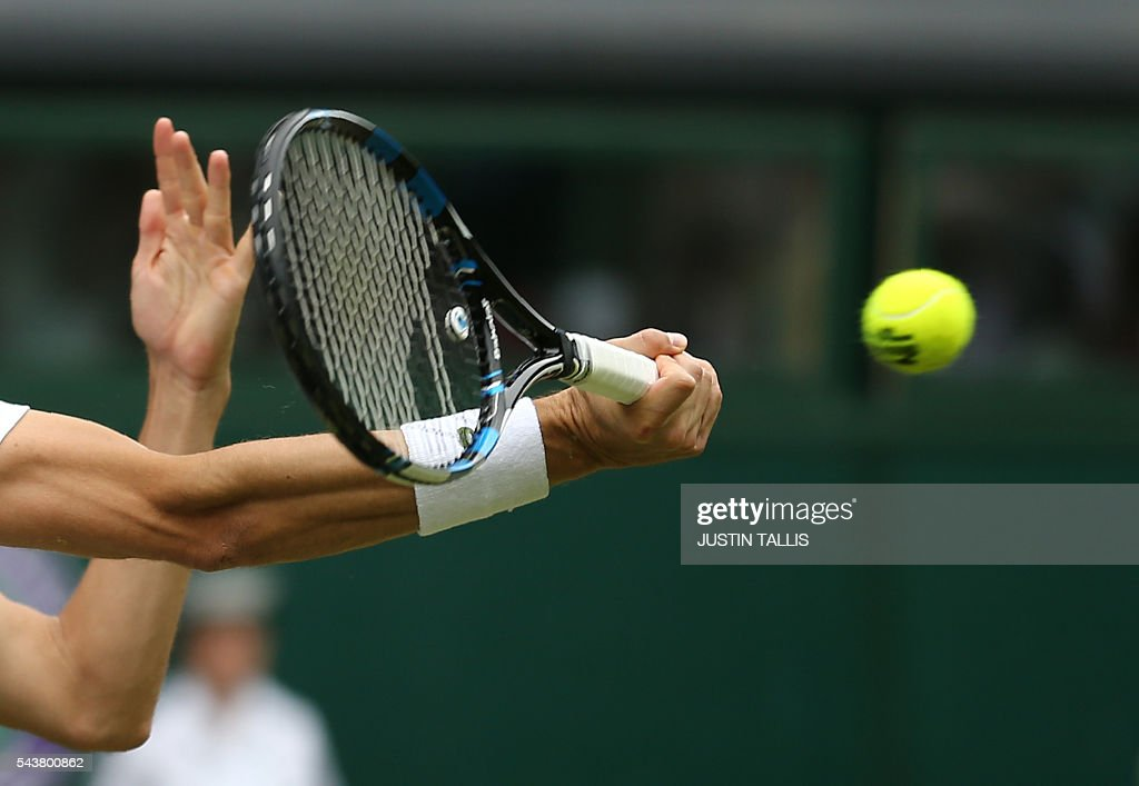 France's Julien Benneteau returns to Japan's Kei Nishikori during their men's singles second round match on the fourth day of the 2016 Wimbledon Championships at The All England Lawn Tennis Club in Wimbledon, southwest London, on June 30, 2016. / AFP / JUSTIN