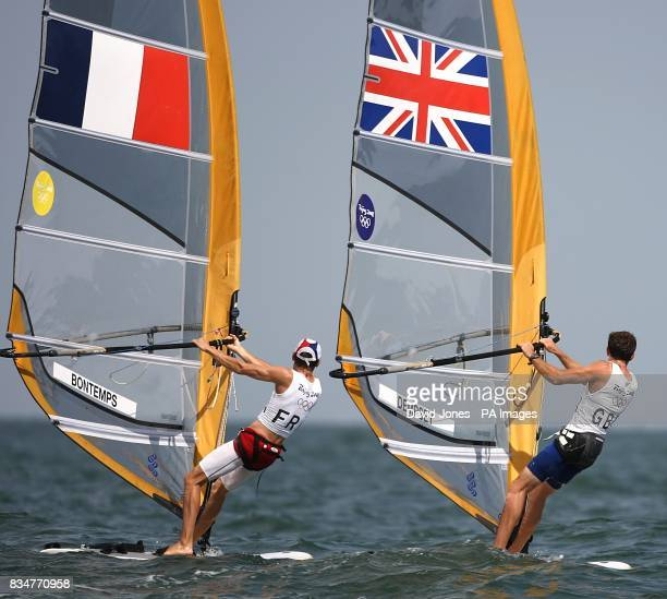 France's Julien Bontemps and Great Britain's Nick Dempsey sail in the final round of the Men's RSX Sailing Competition at the Olympic Games' Sailing...