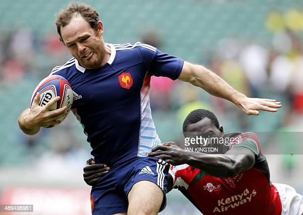 Frances Julien Saubade runs with the ball during the Rugby Sevens Plate semi final between France and Kenya at the IRB Rugby Sevens series at...