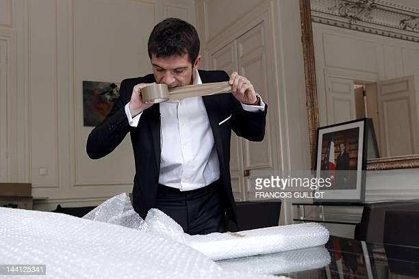 France's Junior Minister for Housing Benoist Apparu packs his personal belongings on May 10 2012 in Paris at his ministry ahead of French rightwing...