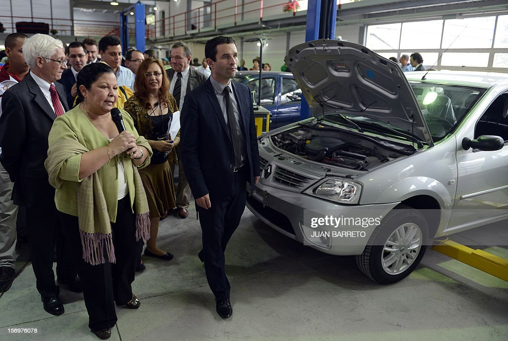 France's Junior Minister for Social Economy, Benoit Hamon (R) walks with Venezuela's Minister of Higher Education Yadira Cordova (L) during a visit to the newly inaugurated University Institute of Technology Federico Rivero Palacio, in Caracas, on November 26, 2012. French automaker Renault said Monday it had signed a letter of intent with the Ministry of Industry of Venezuela to install in Venezuela an assembly plant with a capacity of 30,000 vehicles.