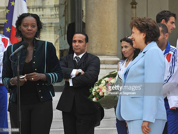 France's Junior Minister for Sports Rama Yade Technical Manager of French Athletics track and field national team Ghani Yalouz and Minister for...