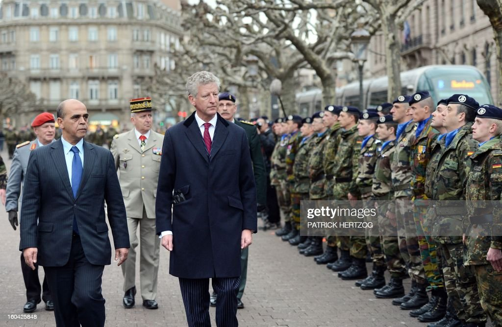 France's Junior Minister for Veterans Kader Arif (L) and Belgium's Defence Minister Pieter De Crem (C) review members of the Eurocorps military contingent during a ceremony marking the end of their intervention in Afghanistan. Eurocorps soldiers, who normally remain based in their respective countries, can be put at the disposal of NATO or the European Union.