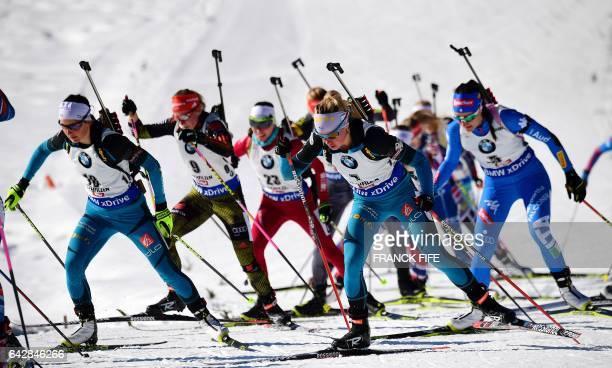 France's Justine Braisaz and Marie Dorin Habert compete during the 2017 IBU World Championships Biathlon Women's 125 km Mass start race in Hochfilzen...