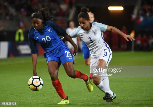 France's Kadidiatou Diani vies with England's Demi Stokes during the friendly football match between France and England at the Hainaut Stadium in...