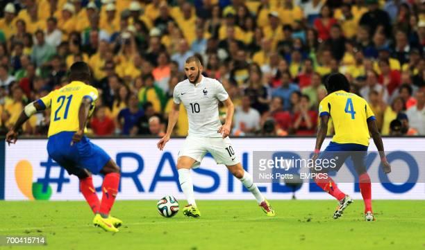 France's Karim Benzema takes on Ecuador's Gabriel Achilier and Juan Carlos Paredes