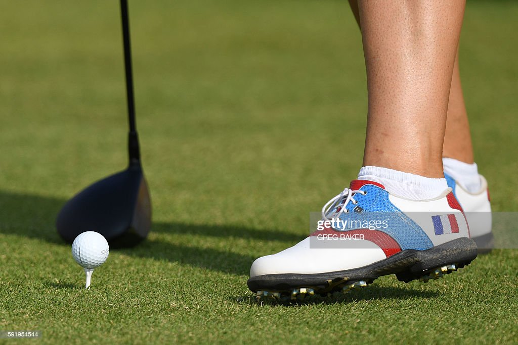 France's Karine Icher's shoes are seen as she competes in the Women's individual stroke play at the Olympic Golf course during the Rio 2016 Olympic...