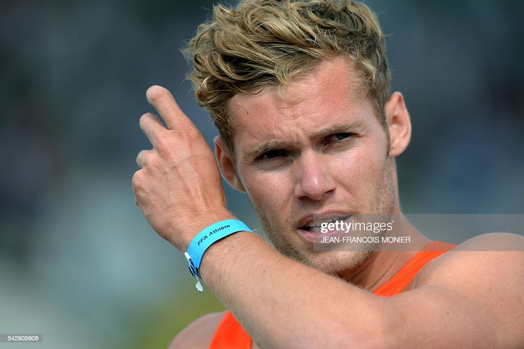 France's Kevin Mayer looks on after competing in the decathlon 110 meters hurdles during French Athletics Elite championships on June 25, 2016 at 'Lac de Maine' stadium in Angers, western France. / AFP / JEAN